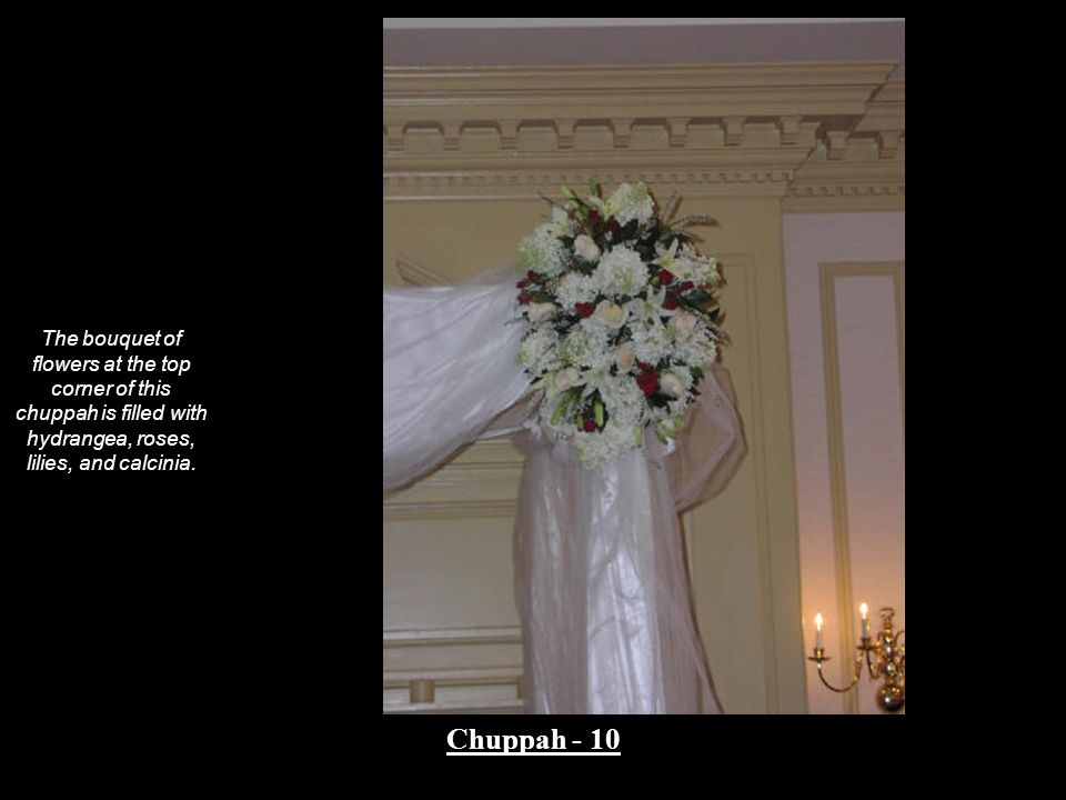 The bouquet of flowers at the top corner of this chuppah is filled with hydrangea, roses, lilies, and calcinia. Chuppah - 10