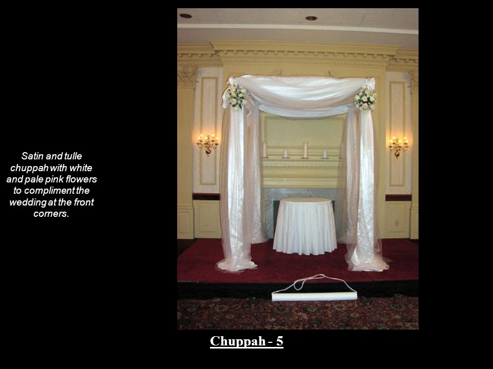 Satin and tulle chuppah with white and pale pink flowers to compliment the wedding at the front corners. Chuppah - 5