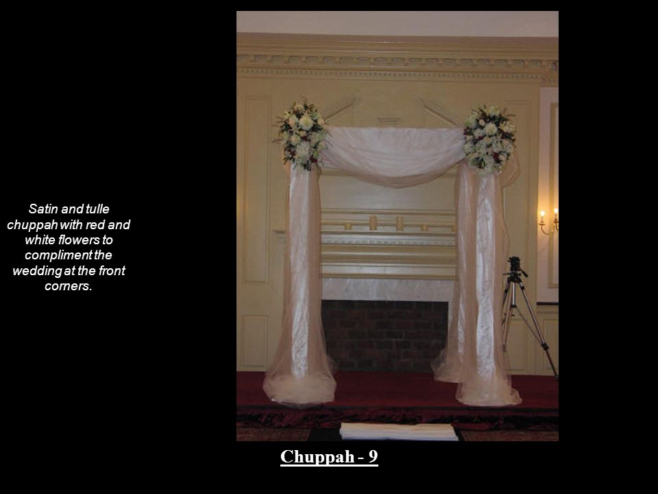 Satin and tulle chuppah with red and white flowers to compliment the wedding at the front corners. Chuppah - 9