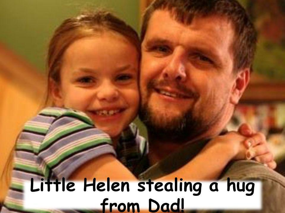 Little Helen stealing a hug from Dad!