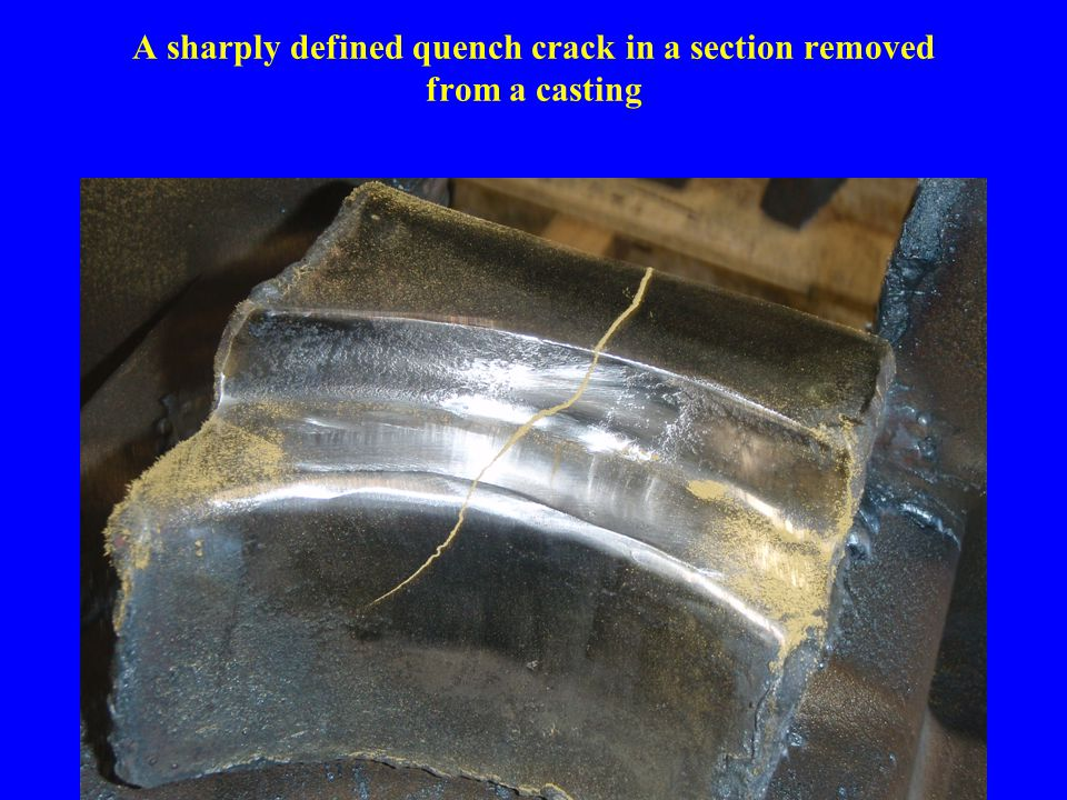 A sharply defined quench crack in a section removed from a casting