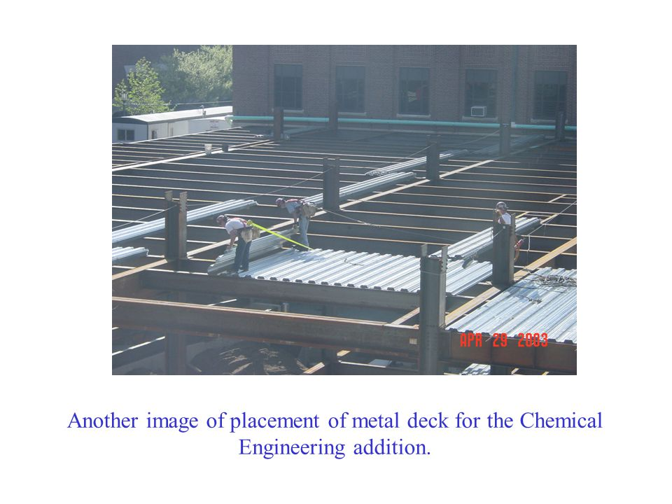 The deck is attached to the beams with puddle welds.