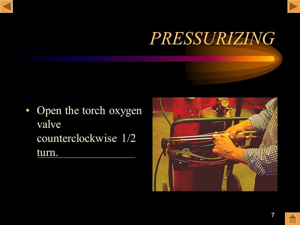 7 PRESSURIZING Open the torch oxygen valve counterclockwise 1/2 turn.