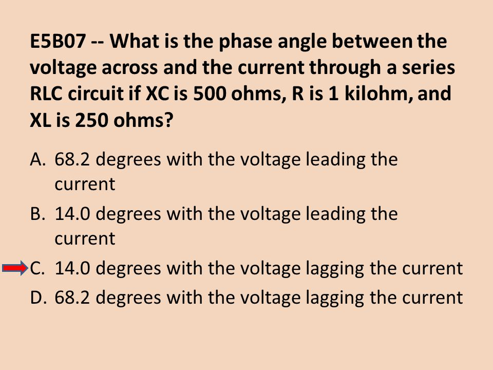 E5B07 -- What is the phase angle between the voltage across and the current through a series RLC circuit if XC is 500 ohms, R is 1 kilohm, and XL is 2