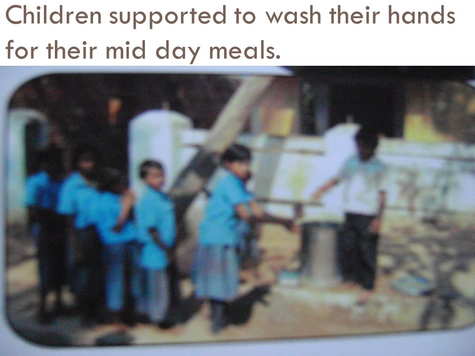 Children supported to wash their hands for their mid day meals.