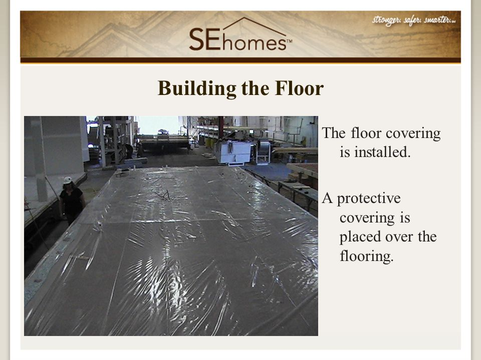The floor covering is installed. A protective covering is placed over the flooring.
