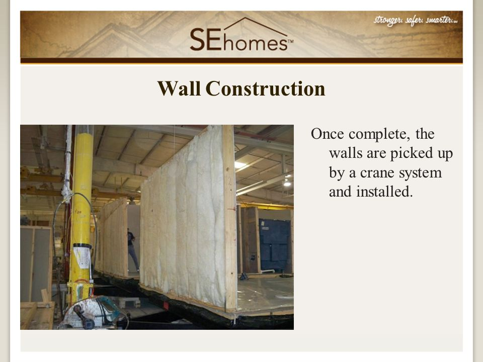 Once complete, the walls are picked up by a crane system and installed. Wall Construction