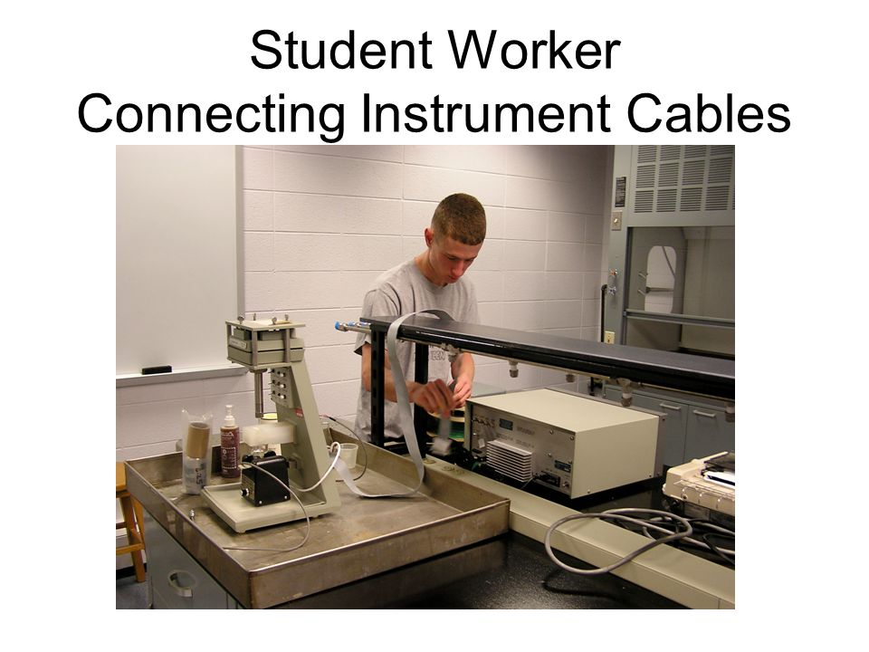 Student Worker Connecting Instrument Cables