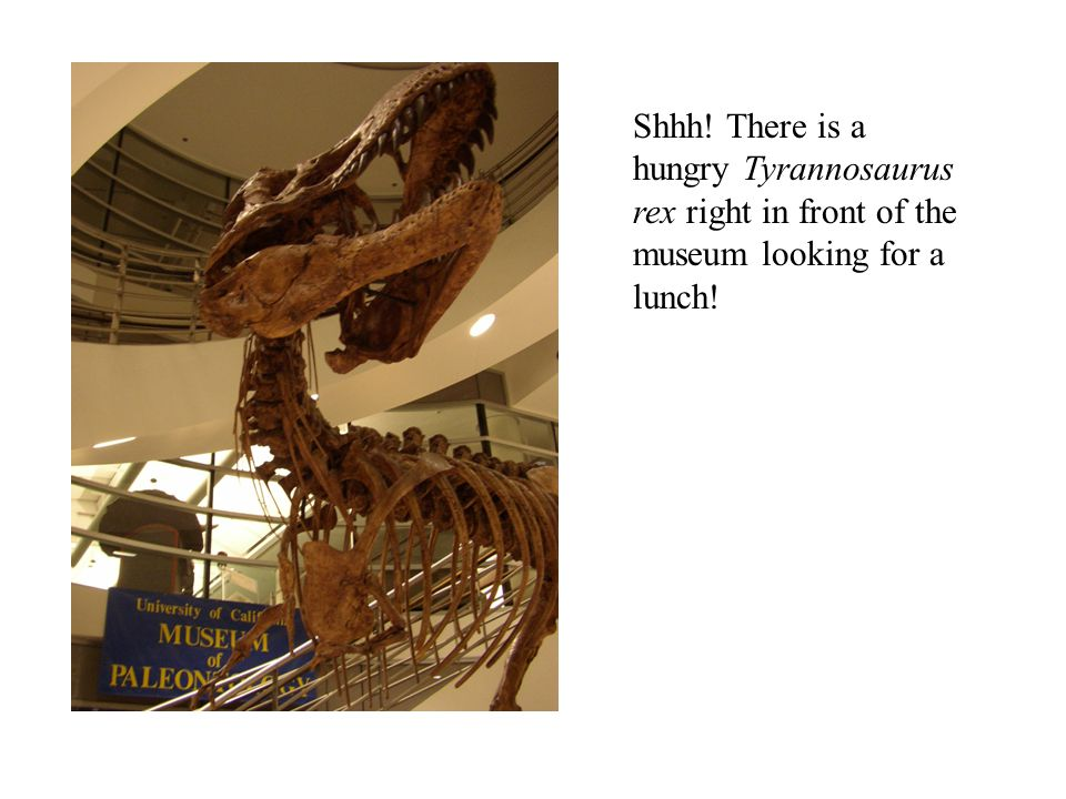 Shhh! There is a hungry Tyrannosaurus rex right in front of the museum looking for a lunch!