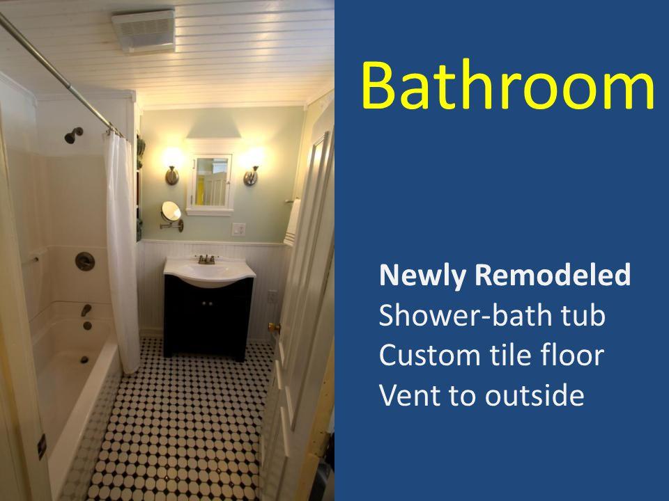 Bathroom Newly Remodeled Shower-bath tub Custom tile floor Vent to outside