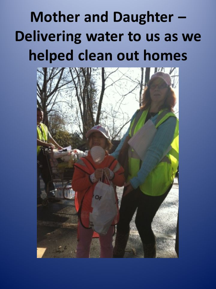 Mother and Daughter – Delivering water to us as we helped clean out homes