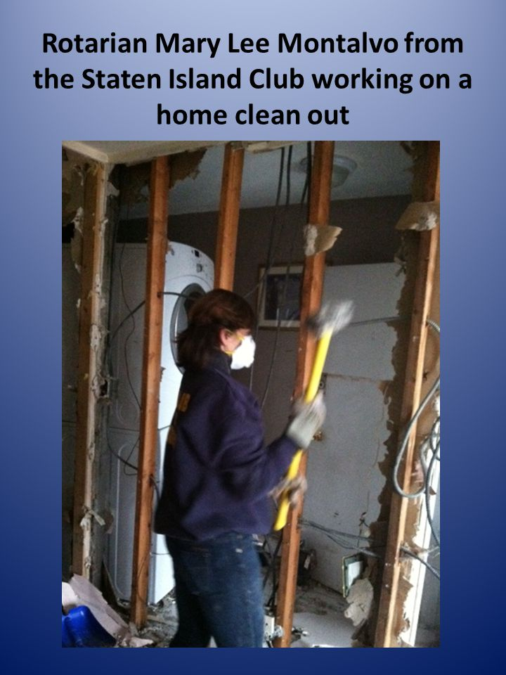 Rotarian Mary Lee Montalvo from the Staten Island Club working on a home clean out
