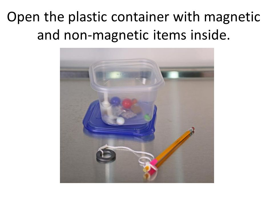 Open the plastic container with magnetic and non-magnetic items inside.
