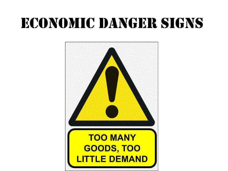 TOO MANY GOODS, TOO LITTLE DEMAND Economic danger signs