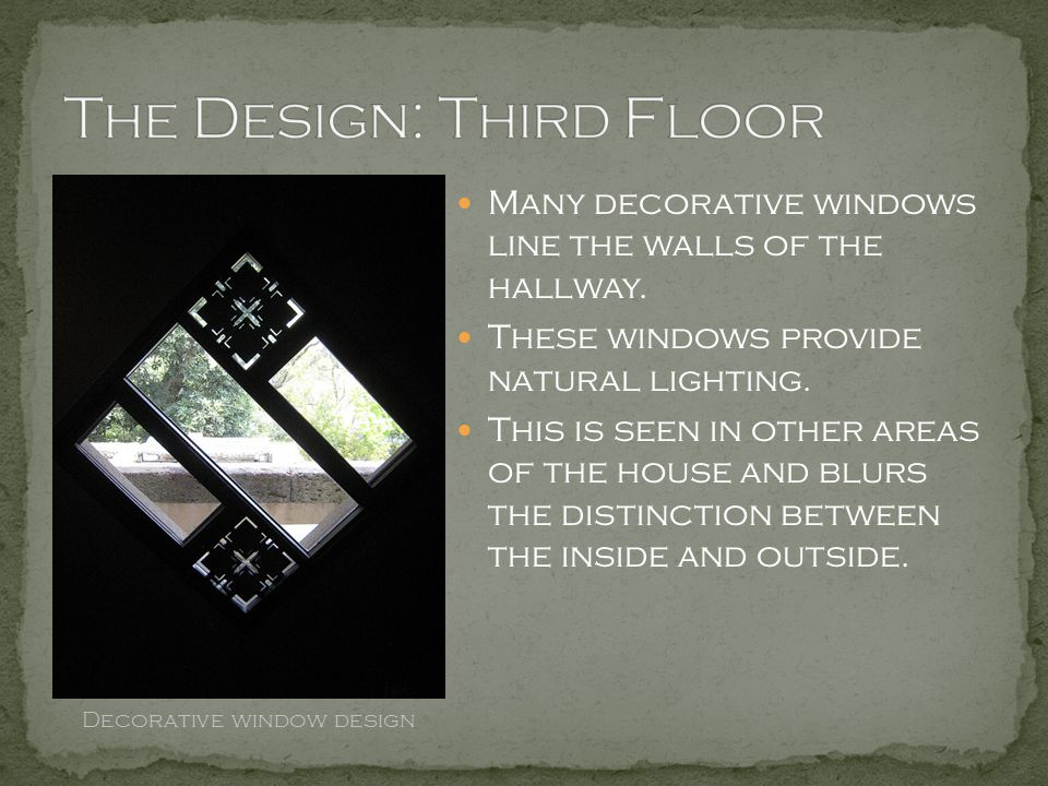 Many decorative windows line the walls of the hallway. These windows provide natural lighting. This is seen in other areas of the house and blurs the