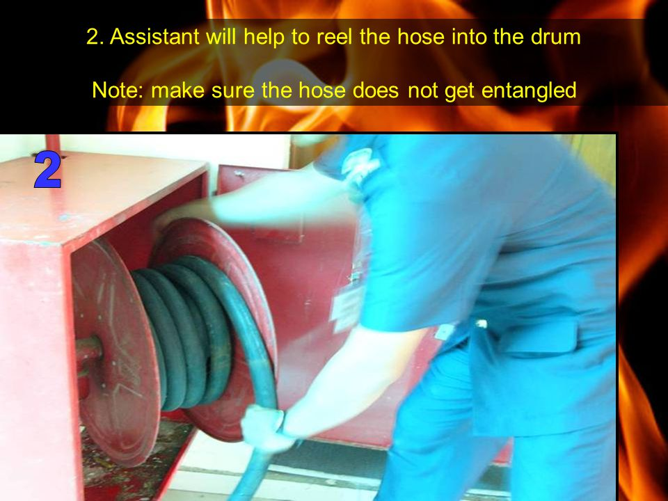 2. Assistant will help to reel the hose into the drum Note: make sure the hose does not get entangled