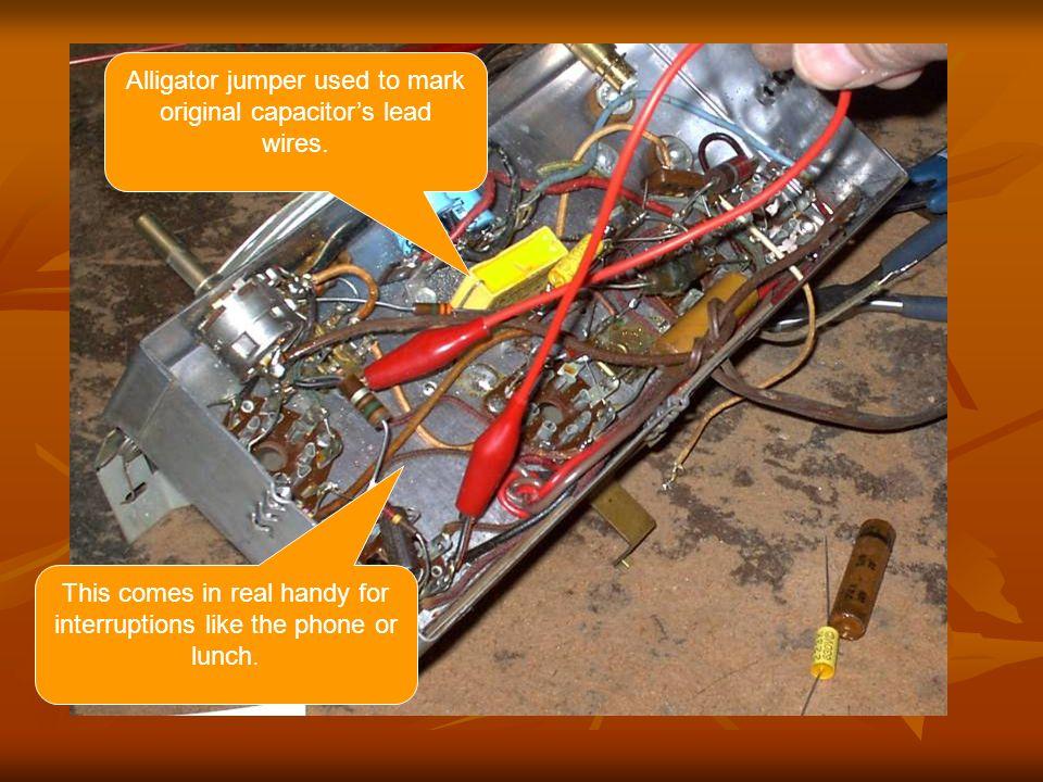 Alligator jumper used to mark original capacitors lead wires.