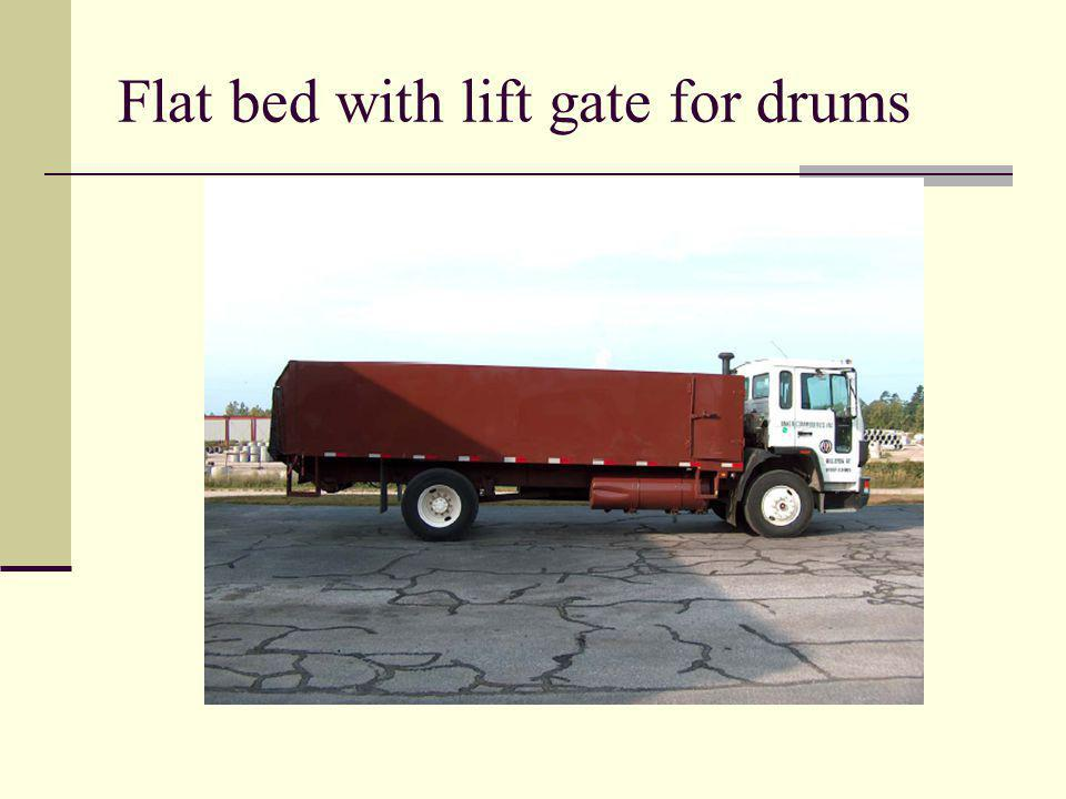 Flat bed with lift gate for drums