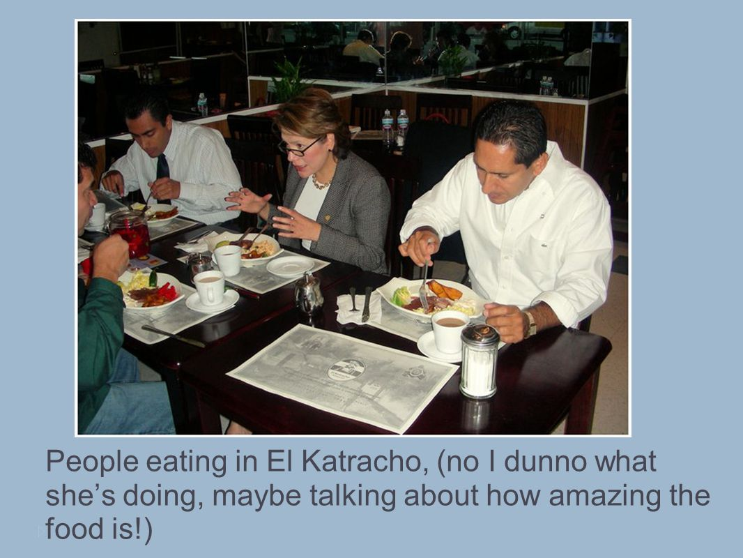 People eating in El Katracho, (no I dunno what shes doing, maybe talking about how amazing the food is!)