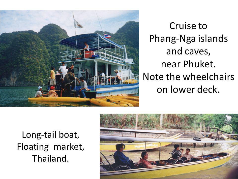 Cruise to Phang-Nga islands and caves, near Phuket. Note the wheelchairs on lower deck. Long-tail boat, Floating market, Thailand.