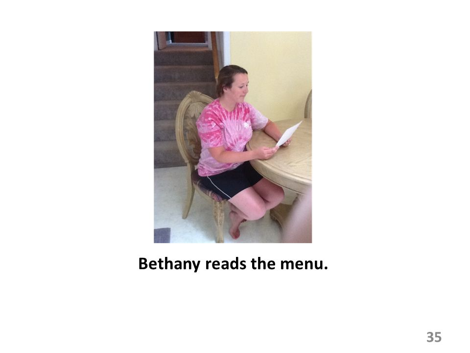 Bethany reads the menu. 35