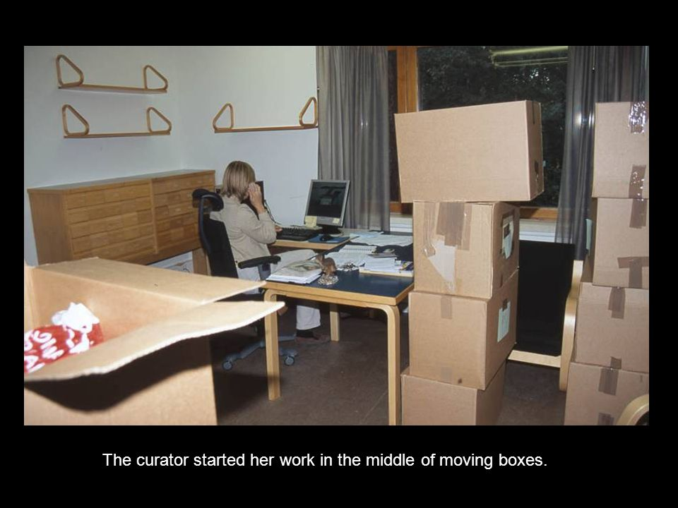The curator started her work in the middle of moving boxes.