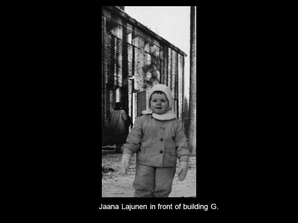 Jaana Lajunen in front of building G.