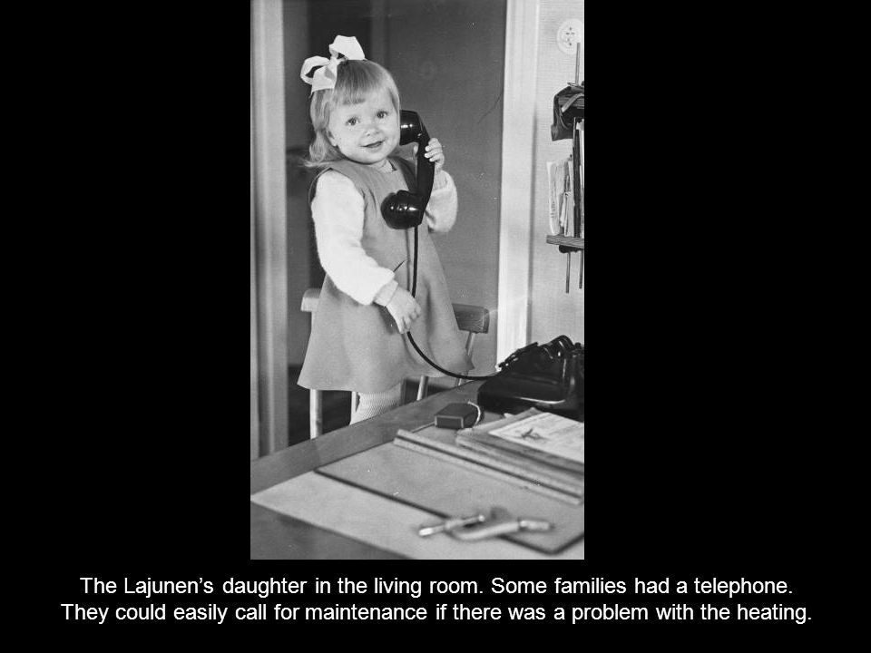The Lajunens daughter in the living room. Some families had a telephone.