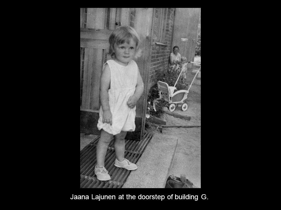 Jaana Lajunen at the doorstep of building G.
