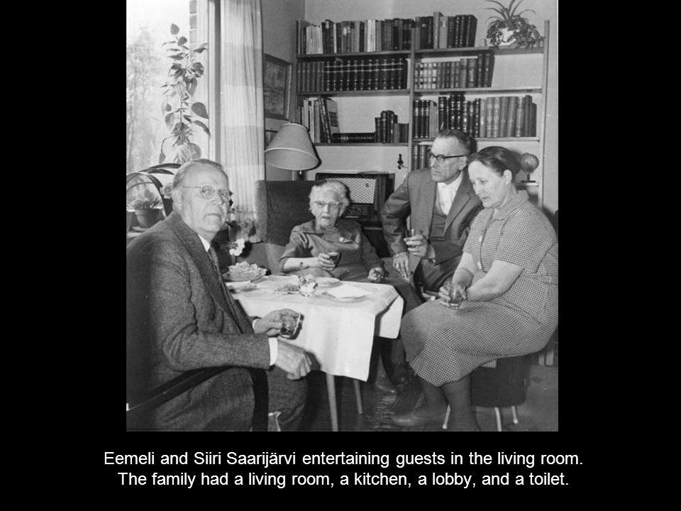 Eemeli and Siiri Saarijärvi entertaining guests in the living room.