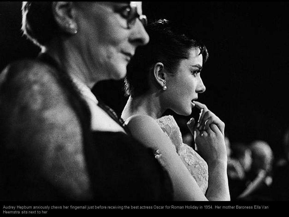 Natalie Wood and Warren Beatty watch the 1962 Academy Awards