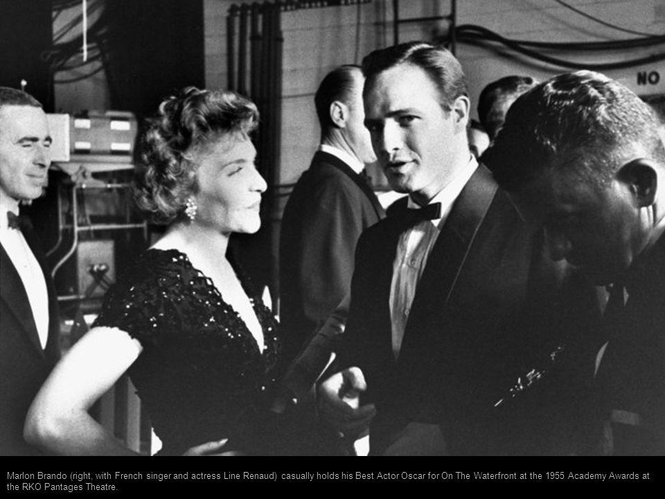 Audrey Hepburn anxiously chews her fingernail just before receiving the best actress Oscar for Roman Holiday in 1954. Her mother Baroness Ella Van Hee