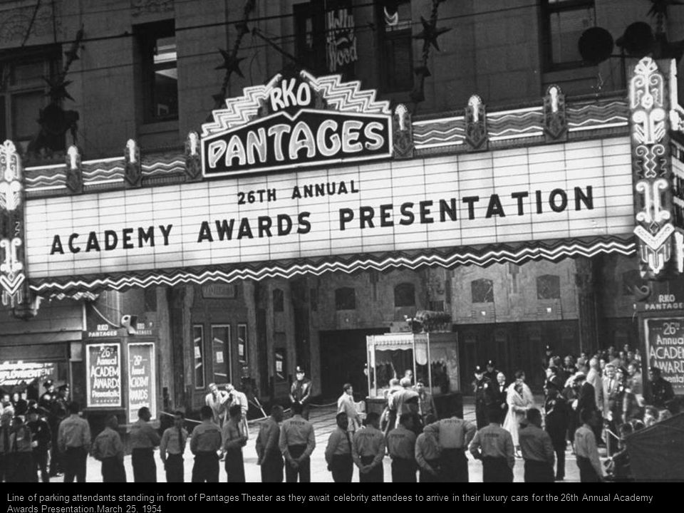 Crowd watching as celebrities arrive for the 26th annual Academy Awards presentation at the RKO Pantages theater.1954