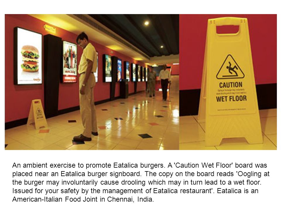 An ambient exercise to promote Eatalica burgers. A 'Caution Wet Floor' board was placed near an Eatalica burger signboard. The copy on the board reads