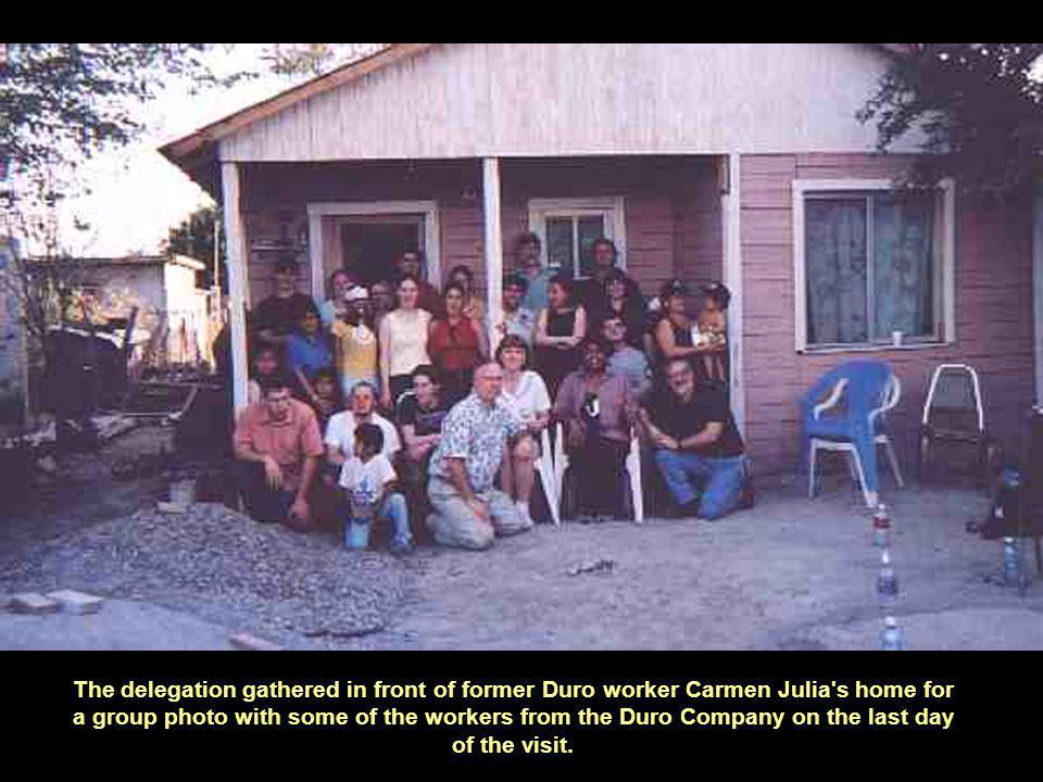 The delegation gathered in front of former Duro worker Carmen Julia s home for a group photo with some of the workers from the Duro Company on the last day of the visit.
