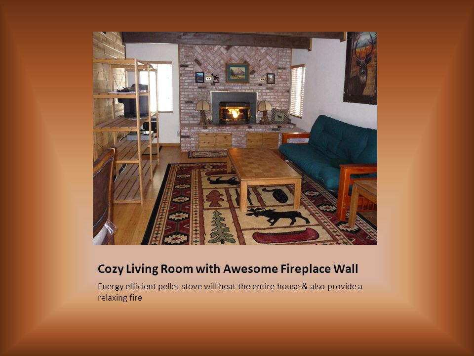 Cozy Living Room with Awesome Fireplace Wall Energy efficient pellet stove will heat the entire house & also provide a relaxing fire