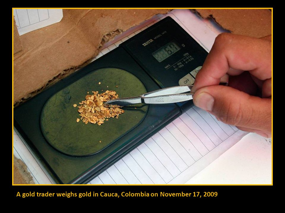 Colombian gold prospectors mine for the precious metal on the river Dagau, Zaragoza province, Cauca, Colombia on November 17, 2009.