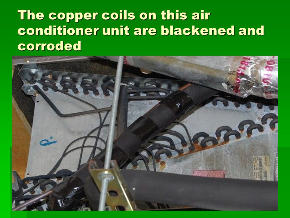 The copper coils on this air conditioner unit are blackened and corroded