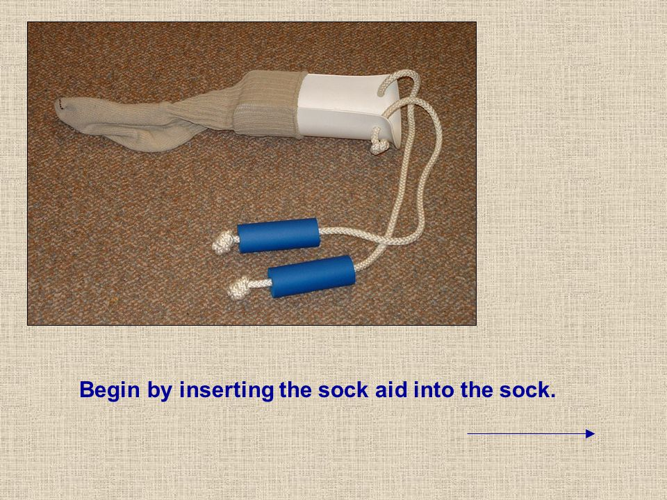Begin by inserting the sock aid into the sock.