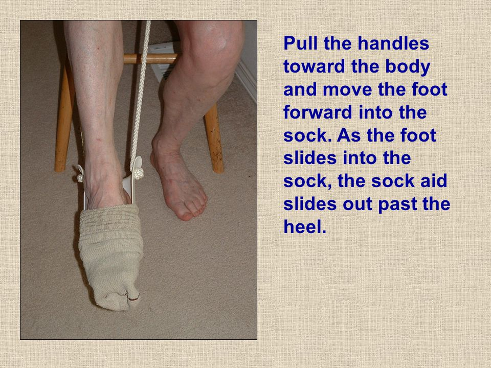 Pull the handles toward the body and move the foot forward into the sock.