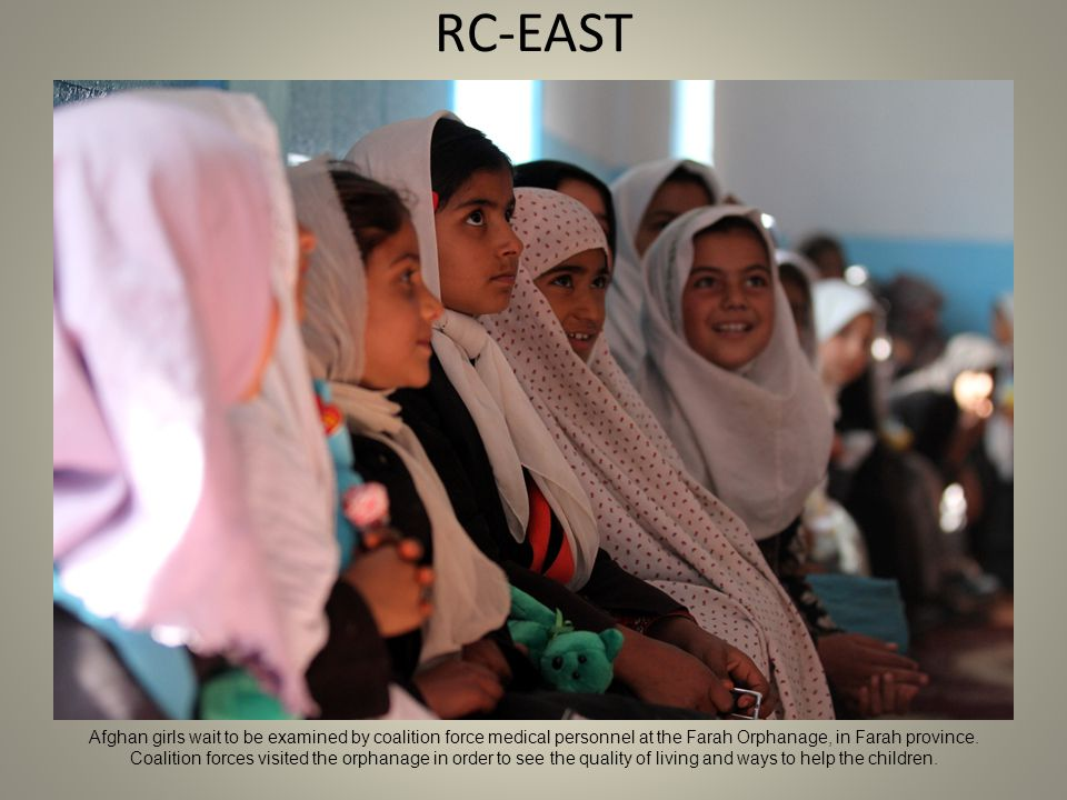 RC-EAST Afghan girls wait to be examined by coalition force medical personnel at the Farah Orphanage, in Farah province.