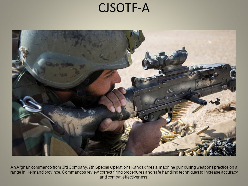 CJSOTF-A An Afghan commando from 3rd Company, 7th Special Operations Kandak fires a machine gun during weapons practice on a range in Helmand province.