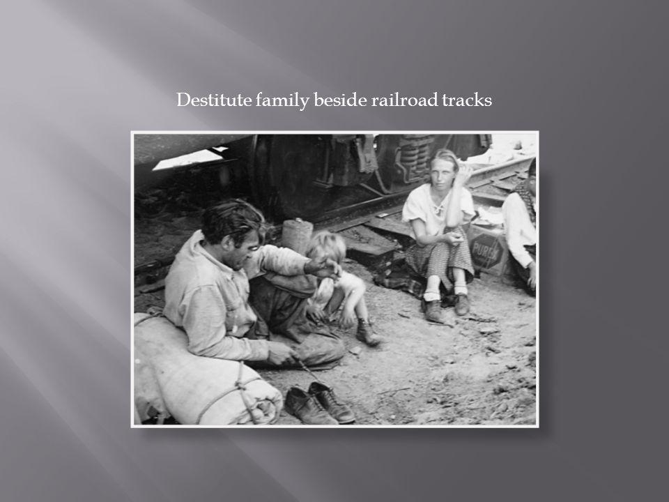 Destitute family beside railroad tracks