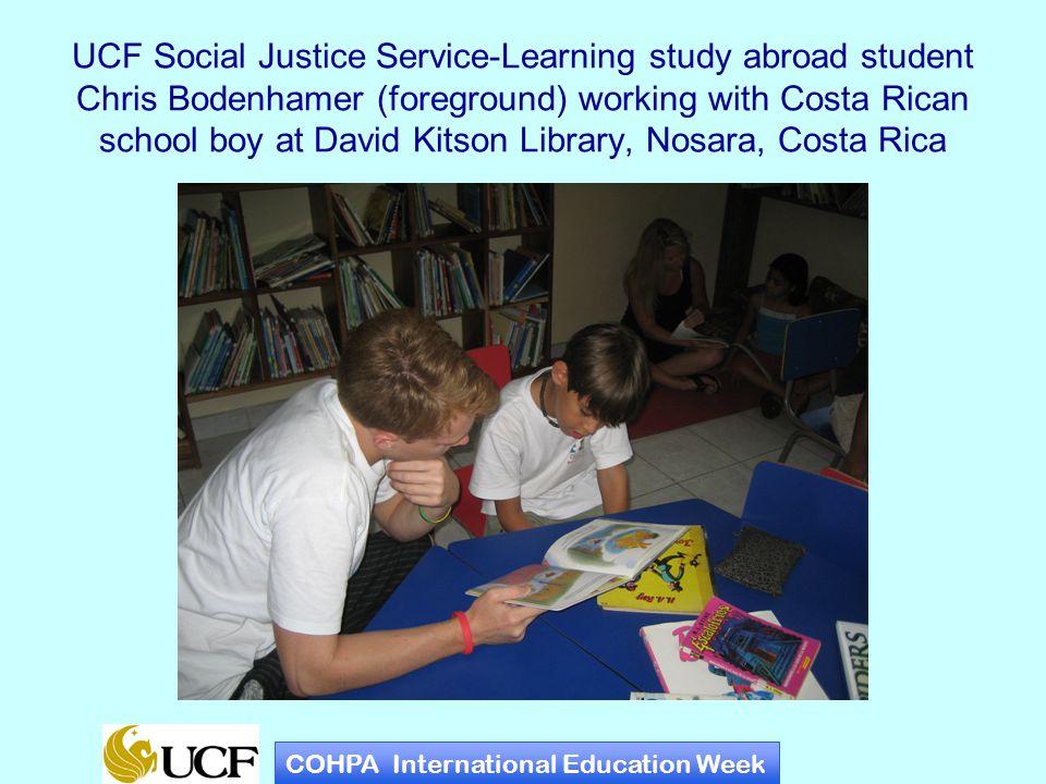UCF Social Justice Service-Learning study abroad student Julio Devere receives gifts at appreciation dinner at la escuela La Esperanza, Costa Rica COHPA International Education Week