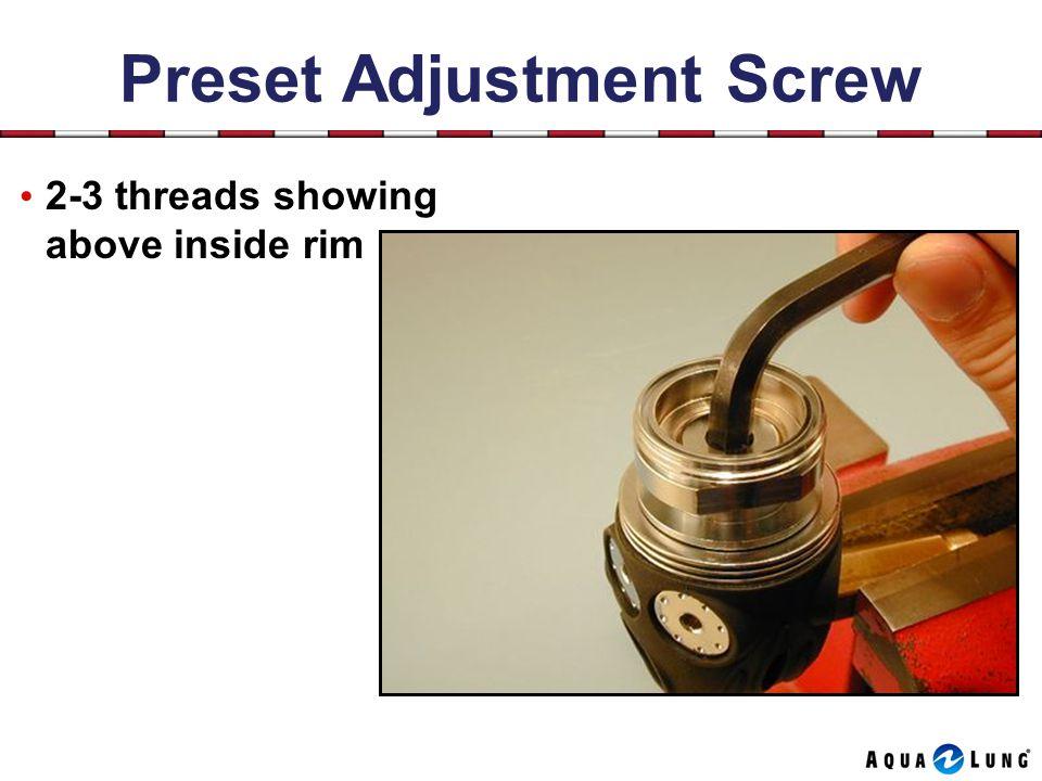 Preset Adjustment Screw 2-3 threads showing above inside rim