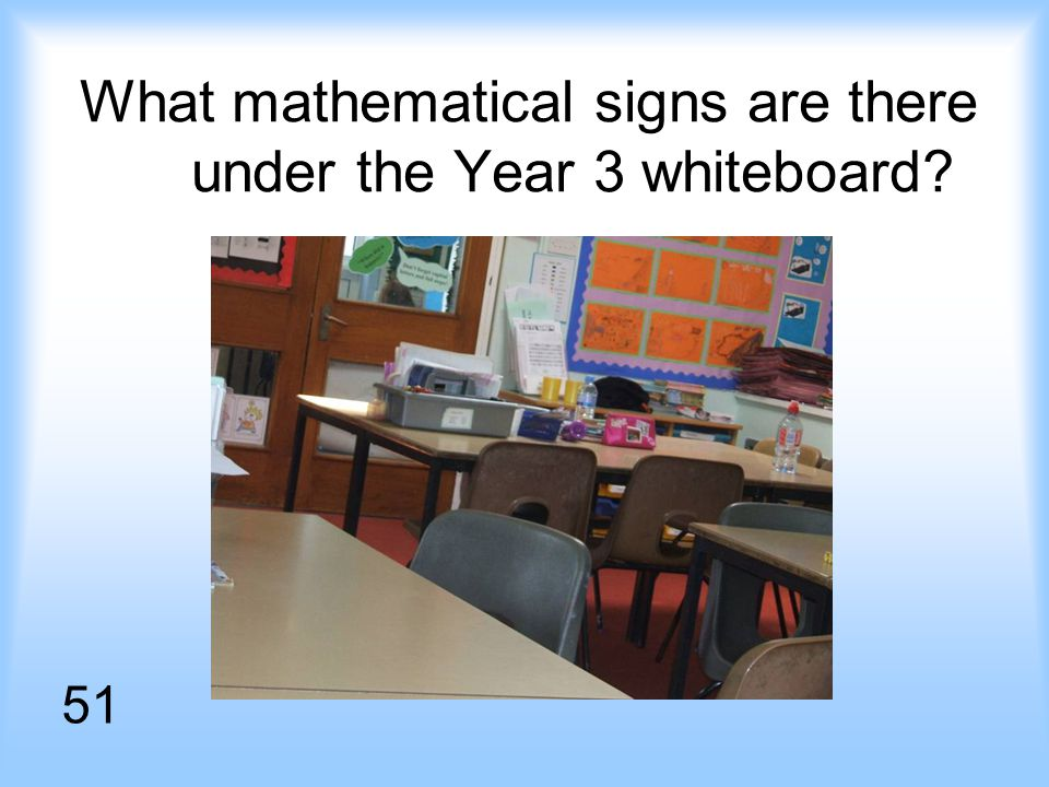 What mathematical signs are there under the Year 3 whiteboard 51
