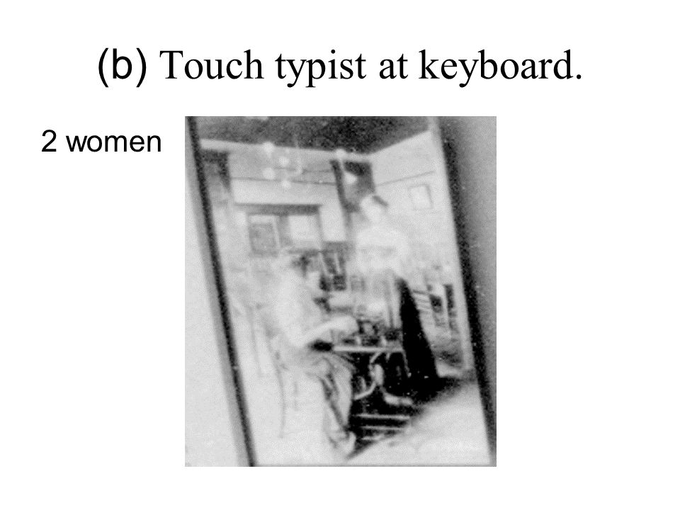 (b) Touch typist at keyboard. 2 women