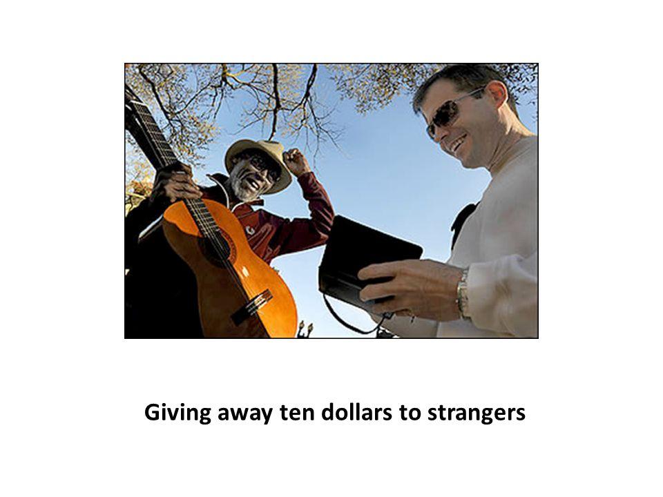Giving away ten dollars to strangers