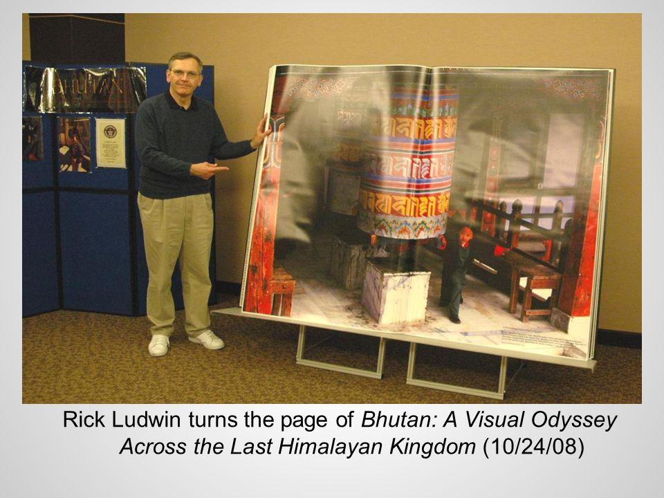 Rick Ludwin turns the page of Bhutan: A Visual Odyssey Across the Last Himalayan Kingdom (10/24/08)