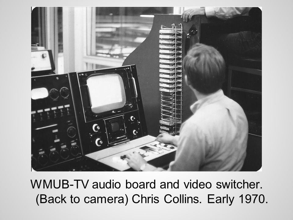 WMUB-TV audio board and video switcher. (Back to camera) Chris Collins. Early 1970.